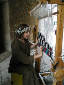 Rievocazione storica del lavoro con il telaio